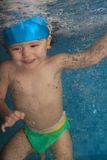 Happy toddler jumping in the pool. Happy smiling toddler jumping in the pool - underwater shoot Stock Photography