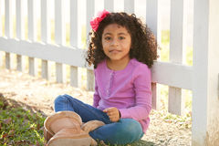 Happy toddler kid girl portrait in a park fence Stock Photos