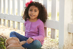 Happy toddler kid girl portrait in a park fence Royalty Free Stock Images