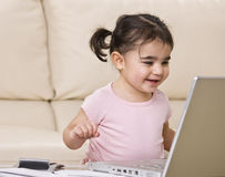 Happy Toddler with Laptop stock photo