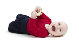 Happy toddler laughing on floor Stock Photos