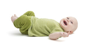 Happy toddler laying on back Stock Photography