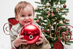 Happy toddler in little Christmas sleigh Stock Photo