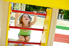 Happy toddler. Happy little  toddler girl on the playground Royalty Free Stock Image