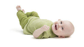 Happy toddler lying on his back Royalty Free Stock Photo