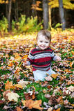 Happy Toddler Outside in the Autumn Stock Images