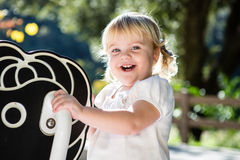 Happy toddler playing Stock Image
