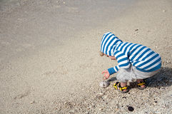 Happy toddler playing on sand beach Royalty Free Stock Image