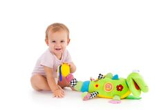 Happy toddler playing with toy Royalty Free Stock Photos