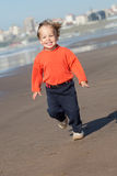Happy toddler running Stock Image
