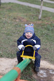 Happy toddler on seesaw Stock Photo
