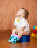 Happy toddler sitting on potty Royalty Free Stock Photo