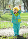 Happy toddler in spring. Happy toddler on grass in spring Stock Photography