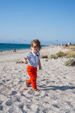 Happy toddler walking with hair in the wind Royalty Free Stock Photo
