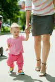 Happy toddler walking on road. Mother with happy toddler walking on road Stock Image