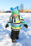 Happy toddler walking in winter Royalty Free Stock Image