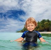 Happy toddler in wet suit Stock Photography