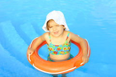 Happy todler girl learning to swim Stock Photo
