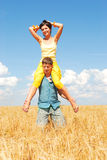Happy Together. Young couple spends time outdoors Royalty Free Stock Image