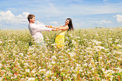 Happy together. Loving couple spends time outdoors Royalty Free Stock Photo