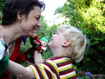 Happy together. Mother and son playing in the garden Stock Image