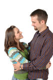Happy Together. Loving happy couple are very much in love with each other. Hug and smile at each other Stock Photography