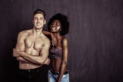 Delighted multiethnic young couple feeling great together royalty free stock photo