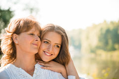 Happy together - mother and teenage daughter outdoor Royalty Free Stock Image