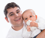 Happy together: young father or single parent with baby isolated. On white background - portrait Stock Photos