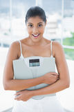 Happy toned brunette holding scales Stock Photography