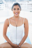 Happy toned brunette listening to music Stock Photography