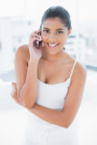 Happy toned brunette phoning with mobile phone Stock Photo