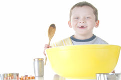Happy toothless boy cooking Royalty Free Stock Photos
