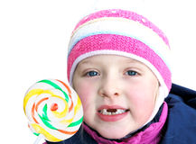 Happy toothless child. Young  toothless child and sugar candy Royalty Free Stock Photos