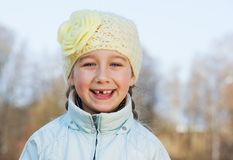 Happy toothless girl outdoors. Picture of a Happy toothless girl outdoors Royalty Free Stock Image