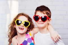 Happy toothless smiling friend. Embracing boy and girl with sunglassec heart shape.  Happy toothless smiling friend Royalty Free Stock Photo