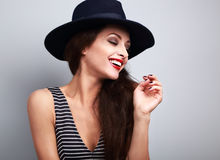 Happy toothy laughing female model profile in black elegant hat Stock Image