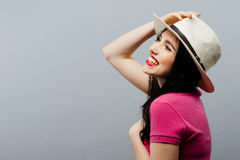 Happy toothy laughing female model profile in t hat royalty free stock images