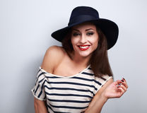 Happy toothy laughing makeup female model in black elegant hat w Stock Photo