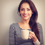 Happy toothy smiling casual young woman with cup of tea. Vintage Royalty Free Stock Photo