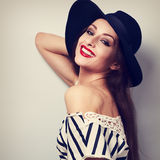 Happy toothy smiling healthy woman in modern clothing and fashio. N hat posing. Vintage toned portrait Royalty Free Stock Image