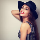 Happy toothy smiling healthy woman in modern clothing and fashio. N hat. Vintage toned portrait Stock Image