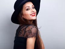 Happy toothy smiling makeup woman in black fashion hat with brig Royalty Free Stock Photos