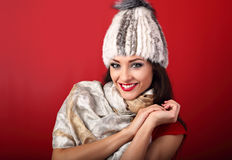 Happy toothy smiling makeup woman in white fur winter hat and fa Stock Photography