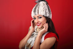 Happy toothy smiling makeup woman in white fur winter hat and fa Stock Photo