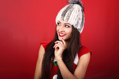 Happy toothy smiling thinking makeup woman in white fur winter h Royalty Free Stock Image