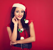 Happy toothy smiling woman in santa clause costume with bright m. Happy toothy smiling woman in  clause costume with bright makeup and red lipstick posing on Stock Photography