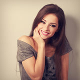 Happy toothy smiling young woman with long hair in fashion blous Stock Photos