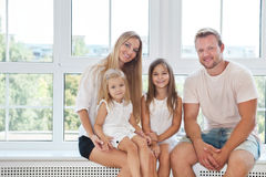 Happy toung family with kids at home Royalty Free Stock Images