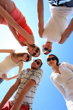 Happy tourism. Cheerful young people having fun on a beach. Great summer holidays Royalty Free Stock Image